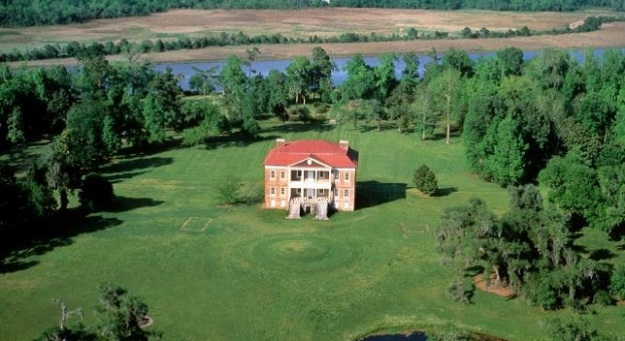 Drayton Hall with Ashley River in the background along with the uplands and march conserved by Drayton Hall.