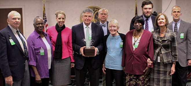 George W. McDaniel, Ph.D. (center) receives the 2014 South Carolina Environmental Awareness Award at a ceremony on October 22, 2015.
